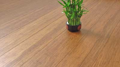 Flooring planks of solid strand woven bamboo